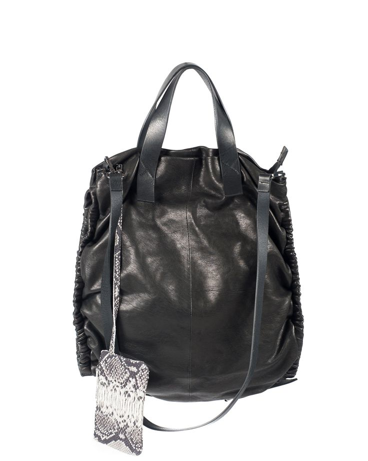 Calf leather rectangular bag with double handle and adjustable leather shoulder strap. Characterized by curled profiles.Opening with zip .Internal zippered pocket and mobile phone pocket. External mini pockt made in python effect leather. Size about 35x39