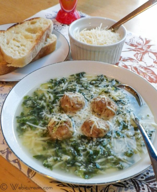 Easy Italian Wedding Soup-Ingredients  1 10 oz package of chopped frozen spinach, thawed      4 eggs      1 cup grated Parmesan cheese      ½ tsp ground white pepper      4 quarts low sodium chicken broth      8 oz Orzo pasta      Mini Pork Meatballs (recipe @link)      Salt & Pepper to taste