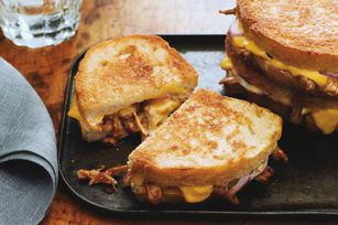 Toasted bread, filled with tender pulled pork, red onions, melted cheese and a hint of barbecue sauce - these Pulled Pork and Red Onion Melts are perfect for lunch, dinner or a casual get-together.