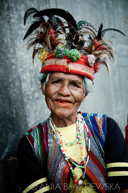 The Philippines, Banaue. Ifugao woman wearing a traditional headdress.  What a wonderful smile!