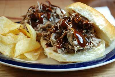 Slow cooked recipe for the best pulled pork you've ever tasted. Serve over slider or hamburger buns...great with coleslaw too! Mollie Stone's Markets #Recipe: BBQ Pulled Pork