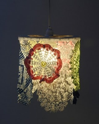 this particular light is not very pretty, but i love the idea of scrap lace and doilies being put  together to create a hanging shade!