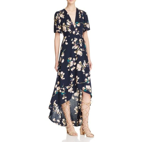With a hint of flirty retro flair, this floral print maxi dress from Cotton Candy La takes shape with a waist-defining wrap silhouette and a leg-baring high/lo…