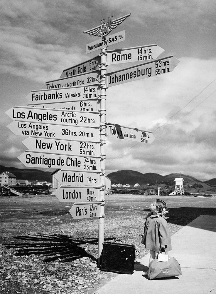 Little girl by the signpost at Bodø Airport, Norway, 1968.  S.A.S. primarily used DC-8s during this period, with a max range of 3700 miles (aprox. 6000 km), so fuel stops would have been routine.  Bodo is up in the northern part of Norway and the airfield was mostly improved over the years for military purposes and has just a single runway. Even today, there are very few direct flights to international destinations