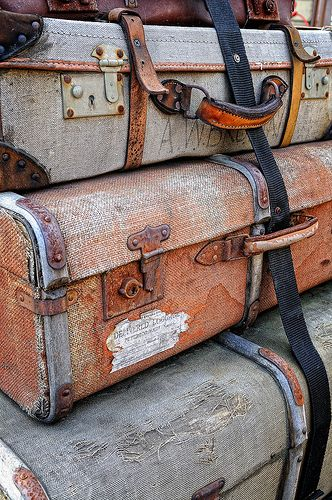 use a small vintage luggage piece and printed vintage postcards as your guest book. perfect for a couple who loves to travel!