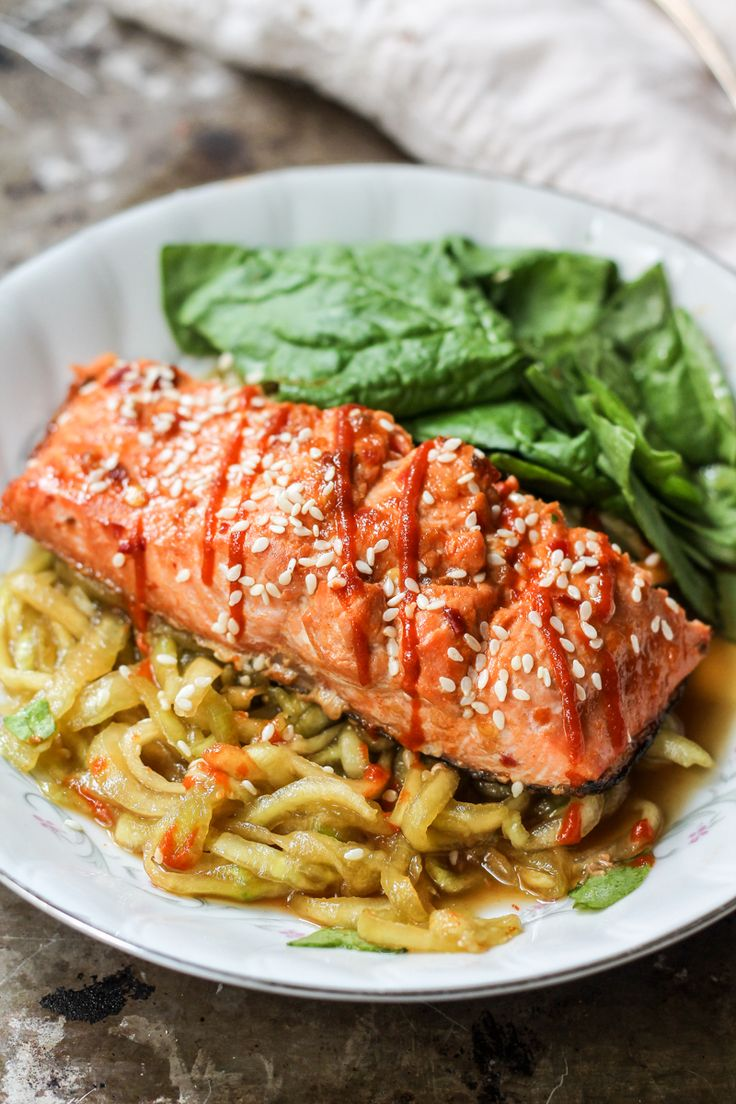Healthy honey marinated sriracha salmon served over a delicious spiralized sesame cucumber noodle salad.: Healthy honey marinated sriracha salmon served over a delicious spiralized sesame cucumber noodle salad.