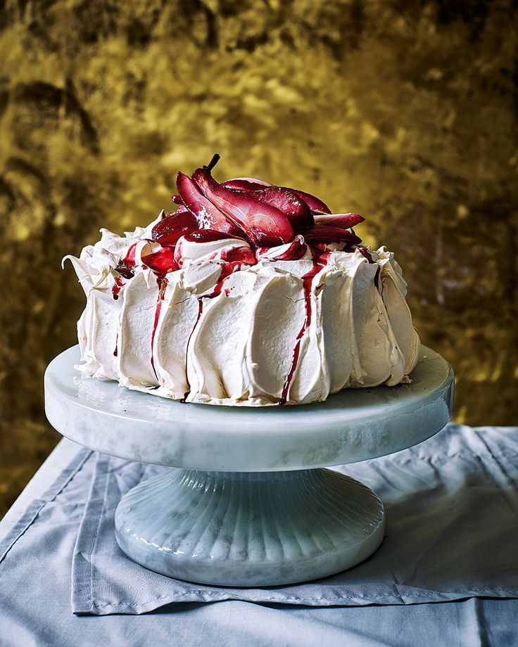Finish your dinner party off with this not-so-traditional pavlova topped with blackberries and boozy, poached pears. This dessert is the perfect centrepiece for any special occasion.