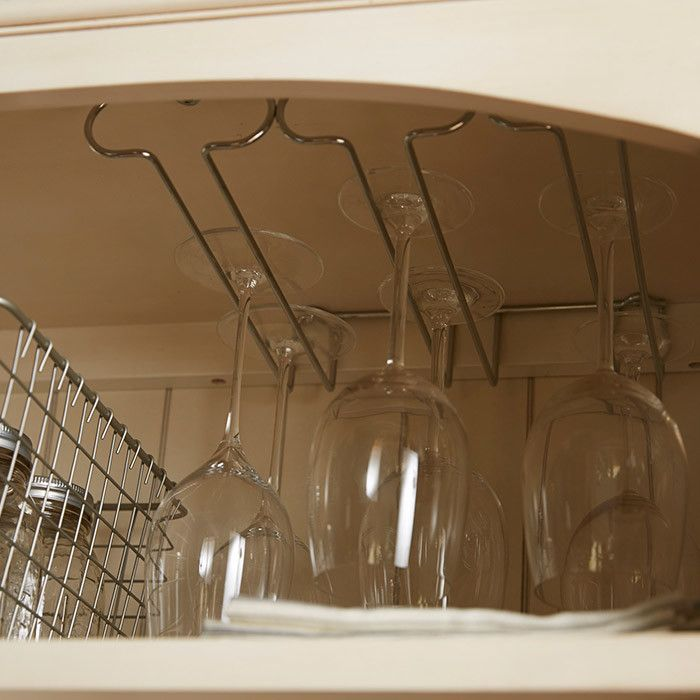 Features:  -Conveniently stores up to nine pieces of stemware.  -Mounts under shelves or cabinets.  -Sturdy steel construction.  -Wipe with a damp cloth and towel dry.  Product Type: -Wine glass rack.