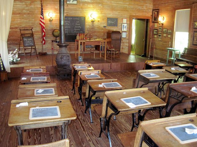 One Room School House by oldsouthvideo, via Flickr. Love old desks. Writing on individual chalk boards. (fiction) School room at Stillwater Springs School. X