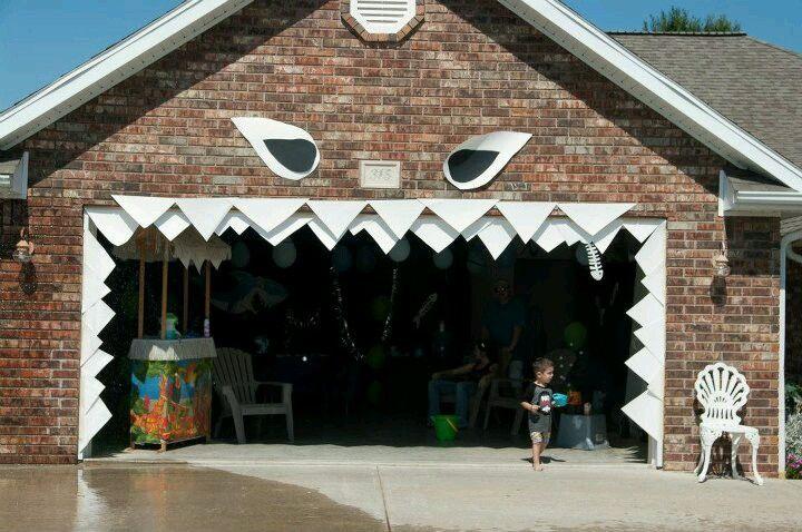 Shark teeth surrounding the garage door opening.  SHUT.  THE.  FRONT - WAIT, GARAGE.  DOOR.
