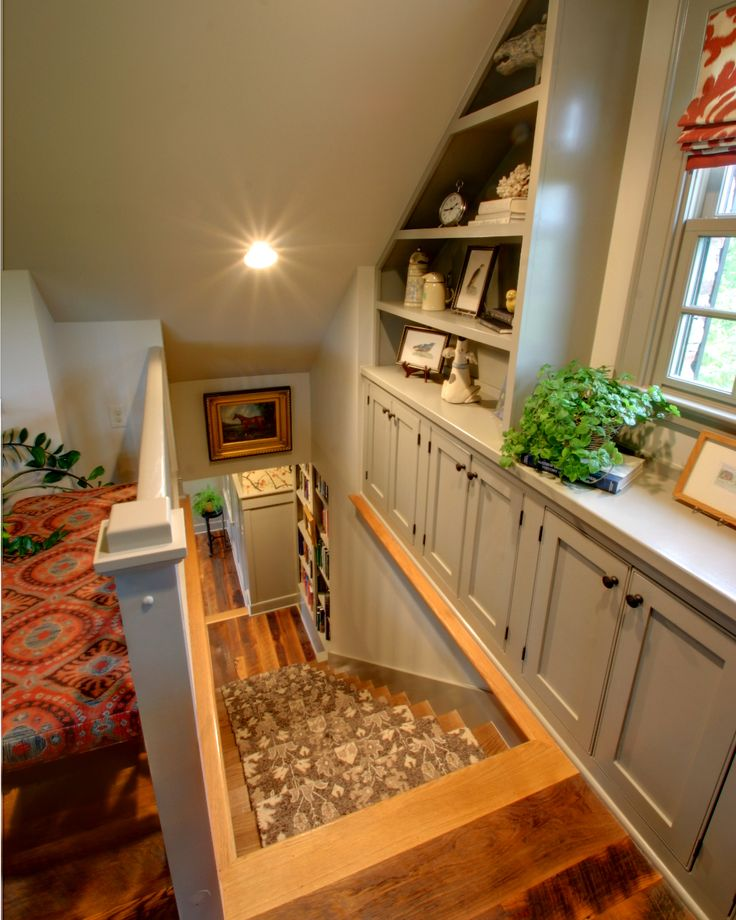 I love this stair.  It creates extra storage space against and otherwise un-utilized exterior wall - just by moving the stair over a bit.