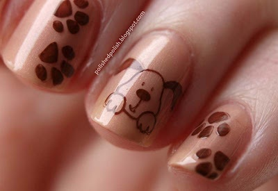 Paw print nails with puppy on middle finger ADORBS!!