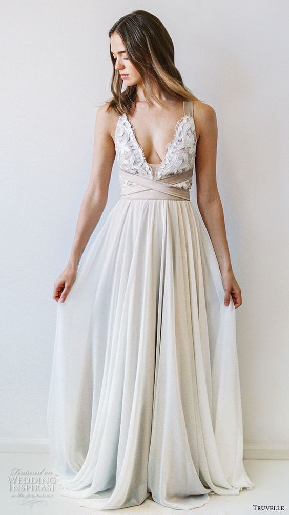 This gorgeous boho wedding dress is perfect for a summer beach wedding.