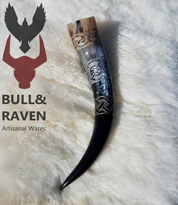 Bands of carved celtic knotwork encircle this horn, painted in tones of aged gold, silver, and bronze.