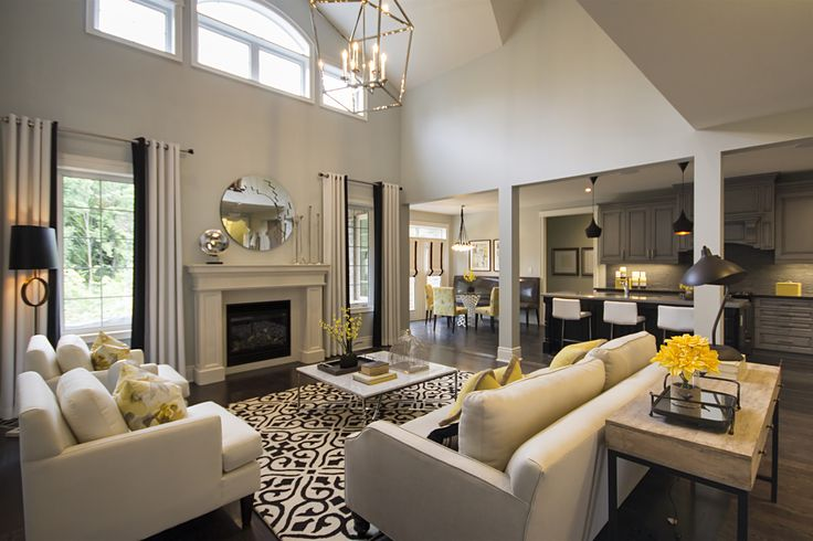 Open concept great room and kitchen area in the Cheshire model home at Fieldstone in Mono
