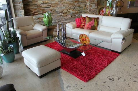 Love the pops of color against the white sofa!
