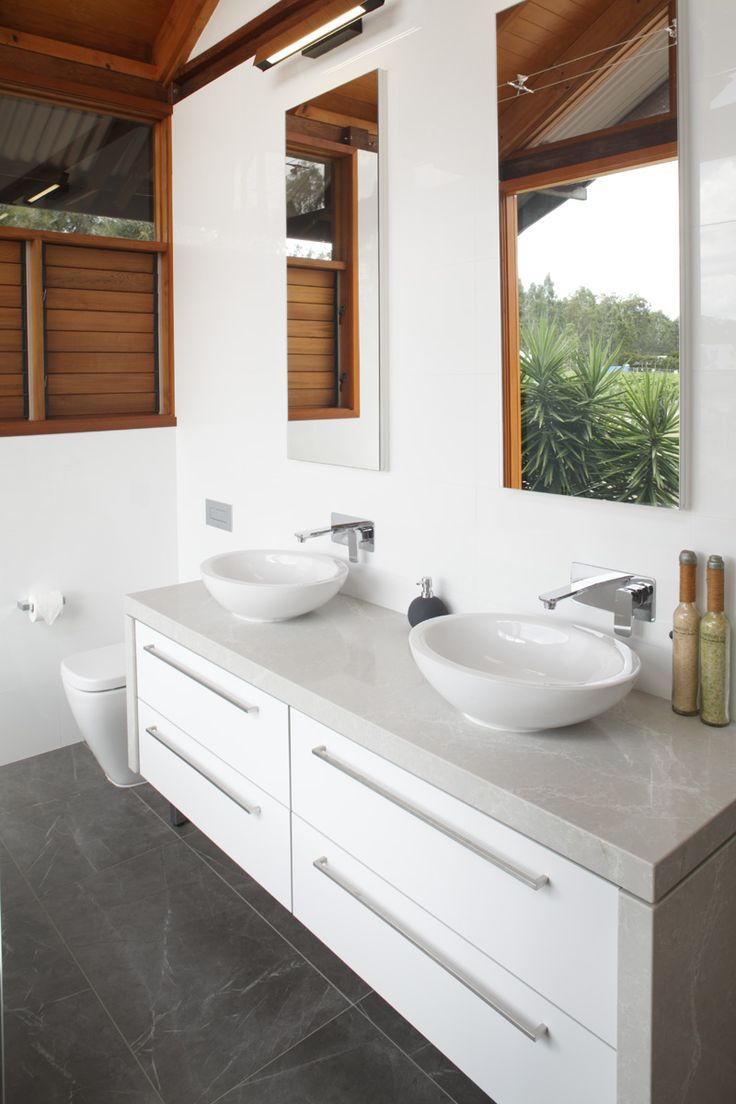 Bathroom and Kitchens SA. Designed by Paul Hutchison. Cabinetry by Blume. Tiles by Saren Tiles.