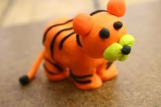 "Clay is fun to work with. You can make almost anything out of it; animals, objects, and more things. This article will talk about how you can make something out of clay in the animal ""category"", tigers. Find a flat, clean workspace to..."