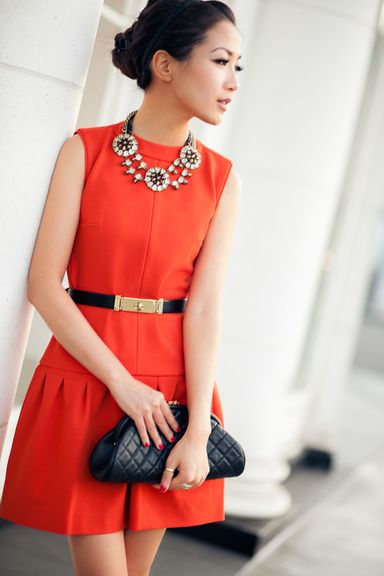 The dress with neck piece,golden belt with black clutch