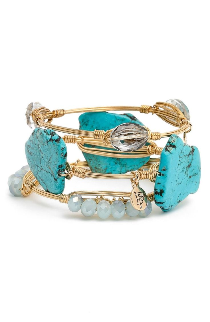 Turquoise-hued howlite and beautifully faceted crystals in shades of soft blue stud this stack of stunning station bracelets from the NSale.