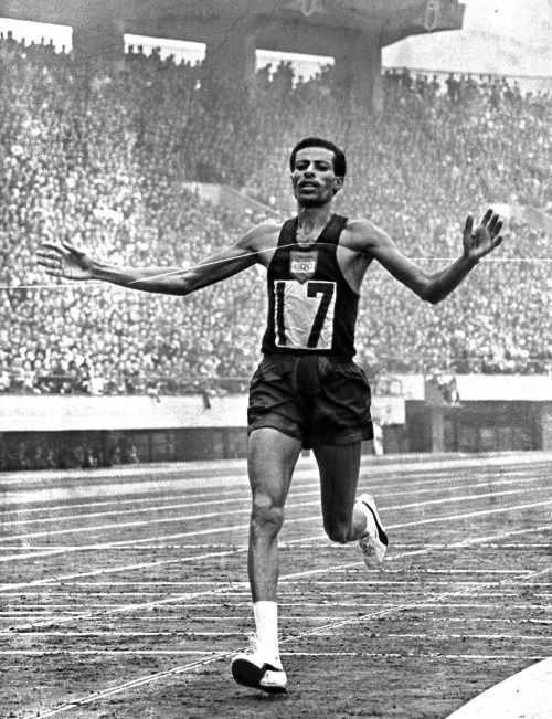 Ethiopian distance runner Abebe Bikila was the first black African to win the gold medal in the Olympic Marathon in 1960, and he ran the race barefooted. He won the race again in Tokyo four years later and became the first person to win the race twice, setting a world record.