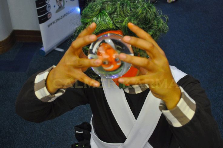 Oompa Loompa crystal ball juggler to hire for Willy Wonka themed events.