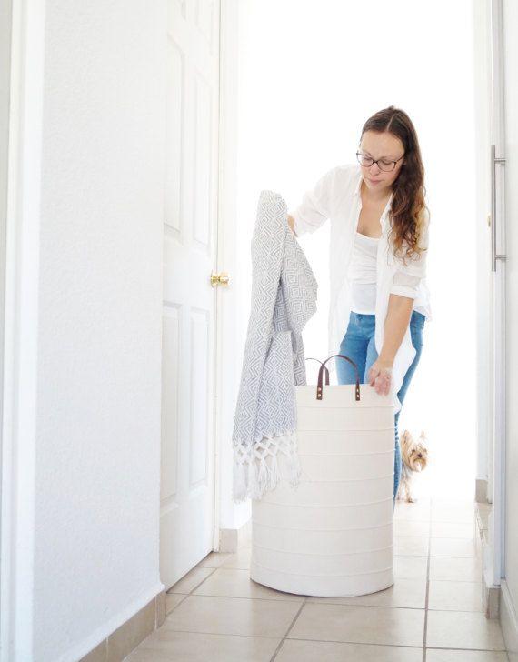 Extra large laundry hamper, oversized storage basket. White Scandinavian interior design. Home decor for kids room, nursery