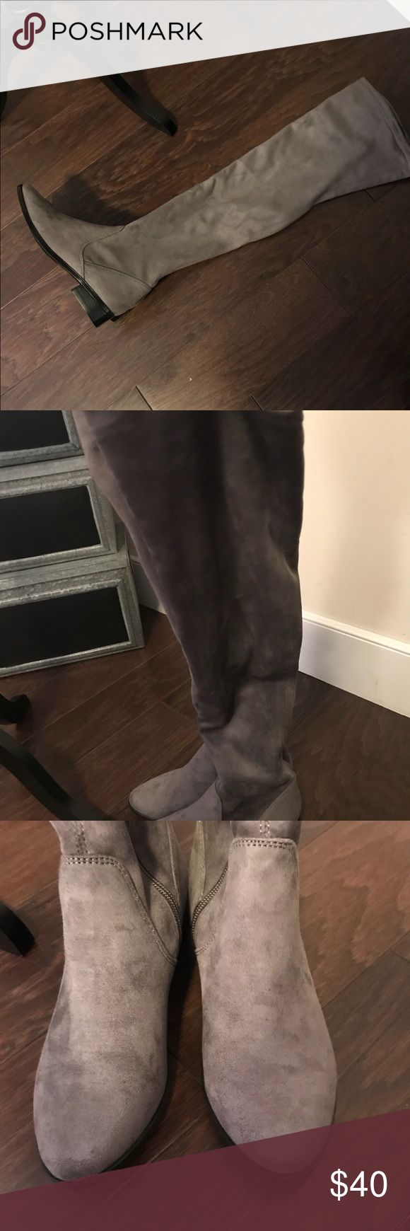 Aldo thigh high boots!! These boots are gray, only worn once, 300 yards outside of the mall. My feet were killing me in my heels, so I stopped in to get flats to get me through the day and wore them out of the store. Realized they were the wrong size. 6.5, I wear a 7.5. So no box!! Aldo Shoes Over the Knee Boots