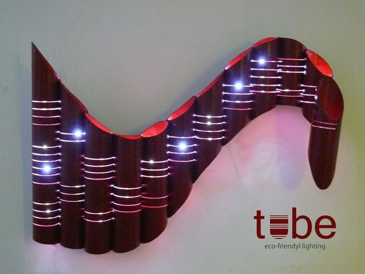 Use large cardboard tube left over from a screen roll and cut lines or holes into it and use Christmas lights.