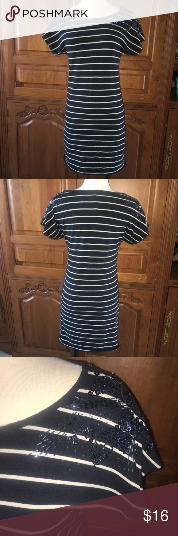 NWOT Forever 21 Navy/ Cream Striped & Sequin Dress NWOT Forever 21 Navy/ Cream Striped & Sequin Dress. Size Large. Stretchy material. Never wore this just tried on. It has gorgeous sequin and beadwork at the shoulder area going from front to back as well. The sleeves are dolman style. Forever 21 Dresses