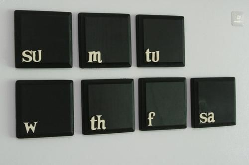 holy crap, i can so make this.  chalkboard paint .. magnets or hang on wall.