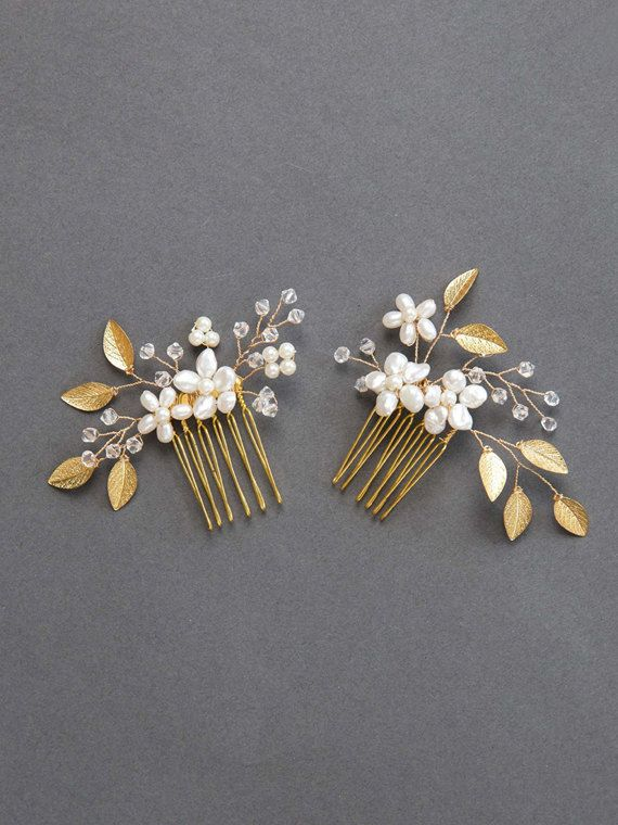 Phoebe Comb Set: Gold  Freshwater pearls blossom amongst the Swarovski crystals, ivory pearl buds, and golden leaves of these handspun golden hair combs. The delicate leaves, Swarovski crystal beads, and ivory pearls offer an earthy femininity to any bridal look. Available in gold, rose gold, and silver. The first & second photos show the Phoebe Comb Set (2 combs). The fourth & fifth photos show the the left comb only (1 comb).  ROSE GOLD…