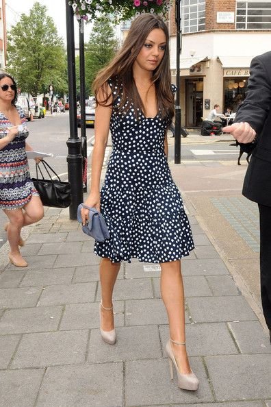 Mila Kunis Platform Pumps - Mila Kunis donned a pair of nude Zenith platforms with ankle straps as she made her way to BBC Radio One studios. She teamed the feminine heels with a flirty polka dot dress.