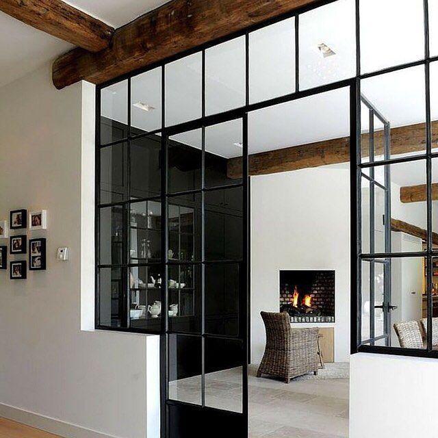 Exposed beams & black steel windows  by renoguideau