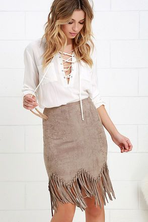 Live a little, and add a little spontaneity to your wardrobe with the Spur of the Moment Taupe Suede Fringe Skirt! Soft vegan microfiber suede starts at a high waist, and cascades to a body-skimming fit, zigzag hem, and knotted fringe. Hidden side zipper with clasp.