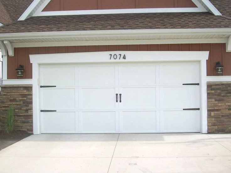 Add hardware and street numbers to dress up garage door