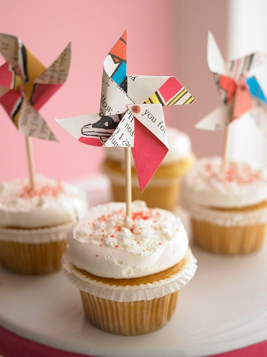 With the pin, poke a hole through all the layers at the center of the pinwheel. Add a drop of glue to the end of a hollow lollipop stick, and push the pin into the stick. Use a pinwheel to adorn any sweet treat.