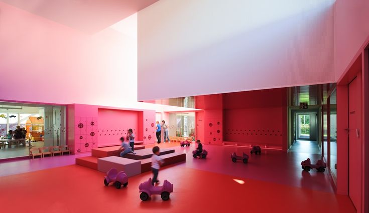 An image of the nursery's main hall, double-height and painted in graduated shades of pink and purple.