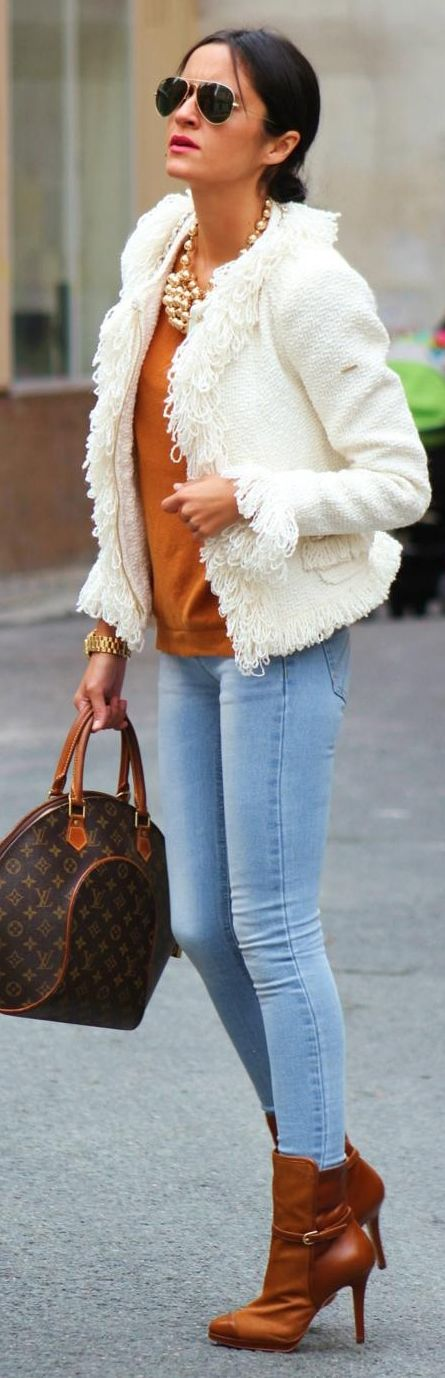 Light wash skinnies tucked in Camel boots, Caramel tee, white loopy jacket, LV bag, chunky gold jewelry...WOW!  GORGEOUS for casual chic!