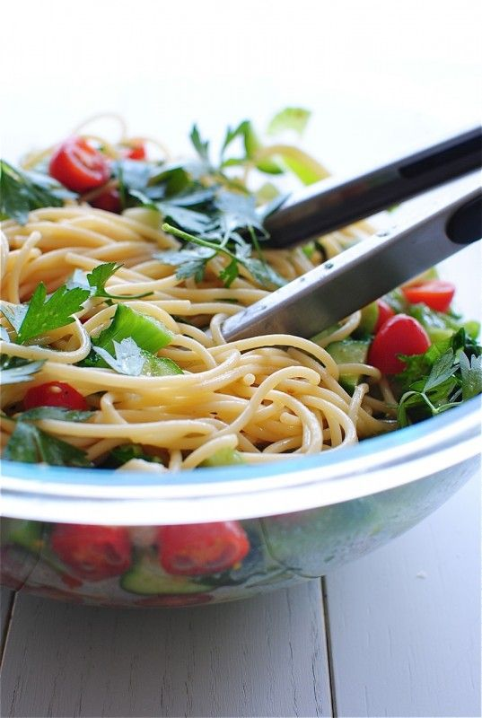 Summer Spaghetti Salad: * 2 small cucumbers, sliced and halved * 1 cup cherry tomatoes, halved * 1 green bell pepper, diced * 2 stalks celery, diced * 2 cups chopped kale * 1/2 cup diced Parmesan cheese * 4 Tbs. extra-virgin olive oil * juice of one lemon * 1/2 cup freshly chopped parsley * 1 pound thin spaghetti * coarse salt and freshly ground pepper