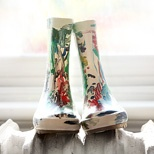 Love this idea.  Let the child paint their rainboots.