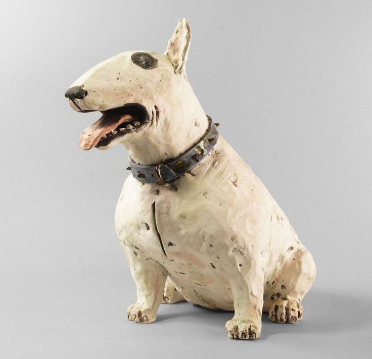 A painted terracotta model of a white Bull Terrier, with black nose and collar, incised marks to base, K A J 8/00, 37 cm high - Price Estimate: £50 - £100