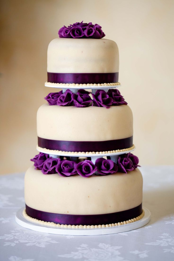 http://brds.vu/rKvbrc~ i love the royal purple roses and ribbons around the tiers, my tiers would be styled differently with more pipping :) maybe purple icing for the pipping on white :)