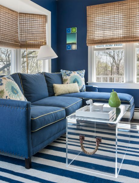 Blue and white decor. Striped carpet. Rope handle on modern coffee table.