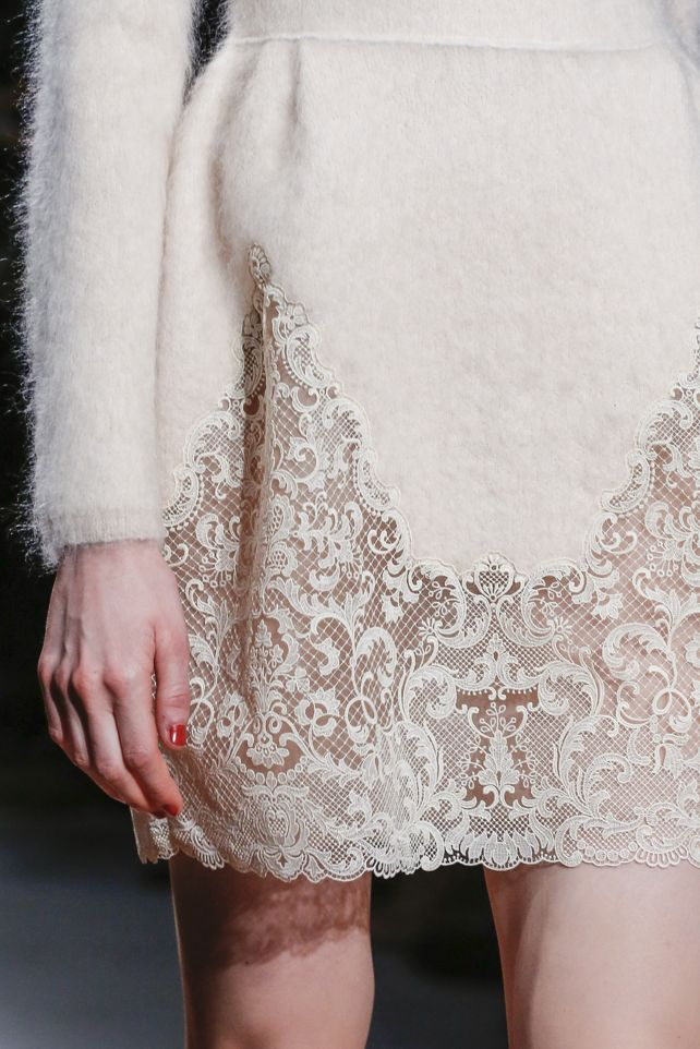 valentino 2014 -  Lace trim at skirt edge with backing trimmed away. Sexy yet concealed.
