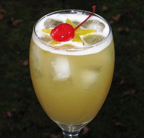 Leg Spreader    (2 oz. Captain Morgan Spiced Rum  2 oz. Peach Schnapps  2 oz. Malibu Coconut Rum  4 oz. Pineapple Juice  Star Fruit or Cherry to garnish)