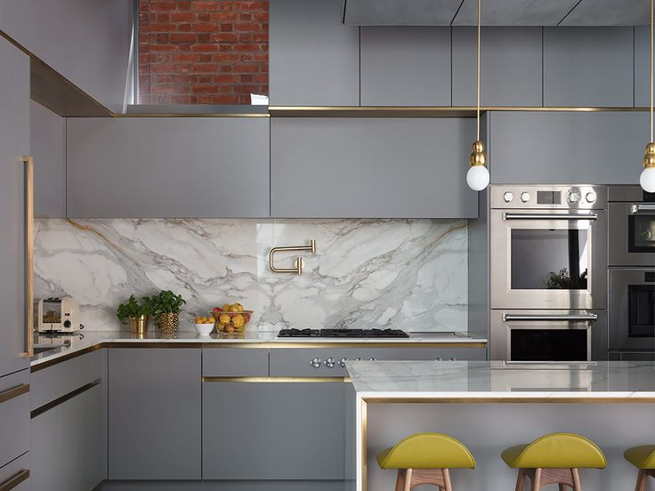 Our Evans kitchen features a burnished, copper matt metallic finish, which contrasts perfectly with its blue-black cabinetry and Carrara marble worktop.