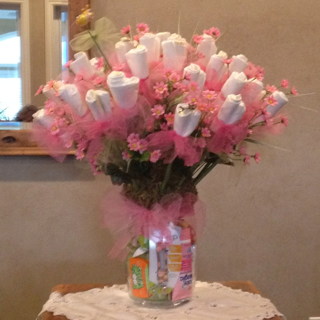 Found the idea on pinterest i did add some pink daisy for Pink diaper bouquet
