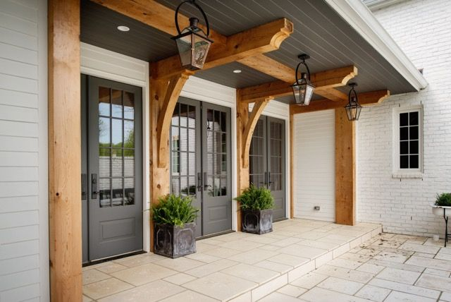"""Gas lanterns add charm to this gorgeous entry way from Allard Ward Architects. #southernhome #patio """"A Fresh Take On Traditional Design"""" www.StyleBlueprint.com"""