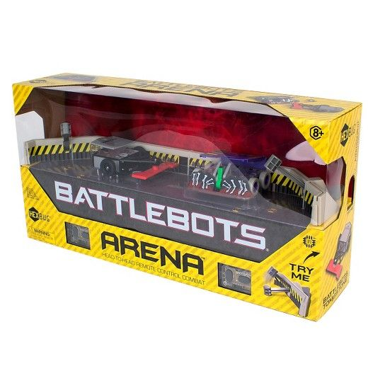 The HEXBUG BattleBots Arena features game-changing attributes such as two push activated<br>pulverizing hammers! A fold-out game board features authentic graphics, plastic side panels and<br>protective glass surroundings, just like on TV! Also included are two miniature remote control<br>adversaries! Tombstone with its grave-making spinning blades and Witch Doctor equipped with its<br>fearsome battering ram armor - ready to fight at your will!